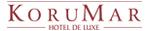 Korumar Hotel De Luxe logosu